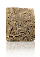 Hittite sculpted Orthostats panel of Long Wall Limestone, Karkamıs, (Kargamıs), Carchemish (Karkemish), 900-700 B.C. Soldiers. Anatolian Civilisations Museum, Ankara, Turkey<br /> <br /> Figure of two helmeted warriors. They have their shield in their back and their spear in their hand. The prisoner in their front is depicted small. A human head is depicted in the left hand of the warrior in the front. The warrior at the rear holds the prisoners sitting on his lap from his hair. Below this figure, which was described small, lies yet another small human figure. <br /> <br /> On a White Background. .<br />  <br /> If you prefer to buy from our ALAMY STOCK LIBRARY page at https://www.alamy.com/portfolio/paul-williams-funkystock/hittite-art-antiquities.html  - Type  Karkamıs in LOWER SEARCH WITHIN GALLERY box. Refine search by adding background colour, place, museum etc.<br /> <br /> Visit our HITTITE PHOTO COLLECTIONS for more photos to download or buy as wall art prints https://funkystock.photoshelter.com/gallery-collection/The-Hittites-Art-Artefacts-Antiquities-Historic-Sites-Pictures-Images-of/C0000NUBSMhSc3Oo