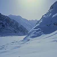 Ski Mountaineers descend Warwan Pass en route from Ladakh to Kashmir during an expedition across India's Great Himalaya Range.