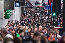 "London, December 20th 2014. Tens of thousands of shoppers descend on central London to scoop up pre-Christmas bargains as retailers offer discount incentives on ""Panic Saturday"". PICTURED: Crowds of Christmas shoppers pack London's Regents Street"
