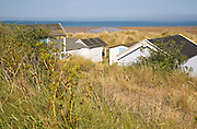 Beach huts in the sand dunes on the coast at Hunstanton, north Norfolk, England