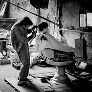Back alley haircut, Macau, China (January 2006)