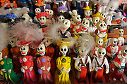 A group of small dolls representing the Death in a store of Mexican souvenirs.