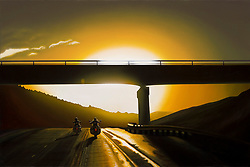 """Some Ride Sunset""<br /> Painting by Scott Jacobs 2010<br /> <br /> A couple rides west on the I-90 between Whitewood<br /> and Spearfish after a summer thunderstorm."