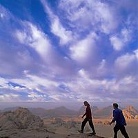 Trekkers hike up an ancient Nabatean trail on Jebel (Mount) Burdah in Jordan's Wadi Rum.