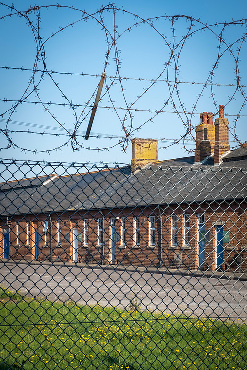 Napier Barracks in Folkestone Kent, recently taken over by the UK home office to be turned into an assessment and dispersal facility for asylum seekers, Folkestone, Kent, Untied Kingdom, 15th September 2020.  Napier barracks was part of Shorncliffe military base, the MOD have sold off large parts of land in recent years for housing development.  (photo by Andrew Aitchison)