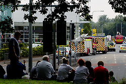 © Licensed to London News Pictures. 11/09/2014. Llanishen, Cardiff, UK.  A 'suspicious package' was found this morning at the HMRC offices in Llanishen in Cardiff, emergency services called and the buildings evacuated at around 10am. Surrounding roads were shut off. Royal Logistic Corps Bomb disposal team was called in and two controlled explosions carried out at around 13:30.  Workers evacuated to a nearby park.The package was found to be harmless - a bundle of dense paper and an electrical device according to Police. Photo credit : Ian Homer/LNP
