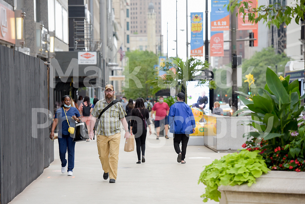 Pedestrians walk along Michigan Avenue in Chicago, Illinois. Photo by Mark Black