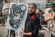 """A newly formed craftsman, Luca Bertozzi shows the sketch of his work for the 2019 Carnival, """"Moon Dream"""", the supposed dream of the US president about a return to the moon."""