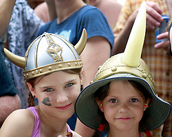 28 April 2013. New Orleans, Louisiana,  USA. .Simone Wuttke (rt - 8 yrs) and sister Olivia (10) enjoy The Honey Island Swamp Band at the New Orleans Jazz and Heritage Festival. .Photo; Charlie Varley.