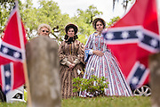 Re-enactors dressed in Civil War era hoop skirts stand at during Confederate Memorial Day events at Magnolia Cemetery April 10, 2014 in Charleston, SC. Confederate Memorial Day honors the approximately 258,000 Confederate soldiers that died in the American Civil War.