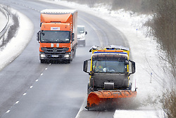 © Licensed to London News Pictures. 12/03/2013.Snow and high winds in Kent over night and this morning (12.03.2013)  Snow plough on the M26 at Wrotham, Kent.. Photo credit : Grant Falvey/LNP