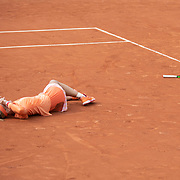 PARIS, FRANCE September 30. Kiki Bertens of The Netherlands falls to the ground after winning her marathon match while in pain against Sara Errani of Italy in the second round of the singles competition on Court Fourteen during the French Open Tennis Tournament at Roland Garros on September 30th 2020 in Paris, France. (Photo by Tim Clayton/Corbis via Getty Images)