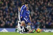Jonjo Shelvey of Newcastle United slides in to tackle Pedro of Chelsea. Barclays Premier league match, Chelsea v Newcastle Utd at Stamford Bridge in London on Saturday 13th February 2016.<br /> pic by John Patrick Fletcher, Andrew Orchard sports photography.