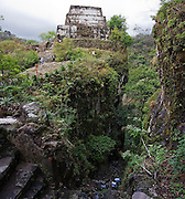 Tourists visit El Tepozteco, an Aztec temple and pyramid perched on a cliff band above the town of Tepoztlan, Morelos state, Mexico on June 13, 2008.