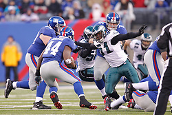 New York Giants quarterback Eli Manning #10 pushes through the line during the NFL Game between the Philadelphia Eagles and the New York Giants.  The Eagles won 38-31 at The New Meadowlands Stadium in East Rutherford, New Jersey on Sunday December 19th 2010. (Photo By Brian Garfinkel)