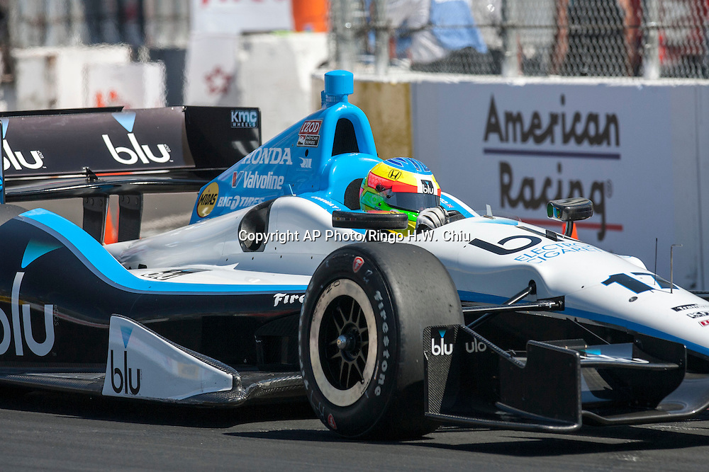 Mike Conway races during the practice for the IndyCar Series 39th Annual Toyota Grand Prix of Long Beach auto race Saturday, April 20, 2013, in Long Beach, Calif.  (AP Photo/Ringo H.W. Chiu)..