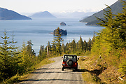 Alaska. Inside Passage and dirt roadway looking up the canal.