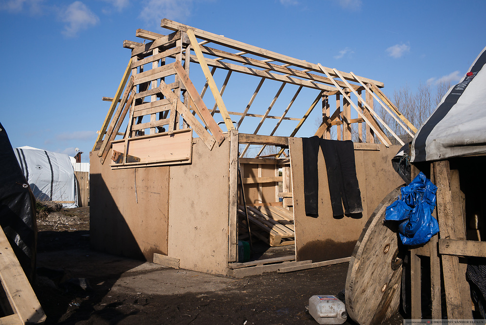Calais, France, 27 feb 2015, Situation of the migrants in Calais, living in jungles. With the help of Medecins du monde, refugees construct winter houses with isolation.