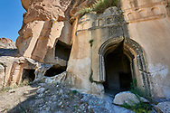 """Pictures & images of Kalburlu (St. Epthemios) church, 9th century, the Vadisi Monastery Valley, """"Manastır Vadisi"""",  of the Ihlara Valley, Guzelyurt , Aksaray Province, Turkey.<br /> <br /> Kalburlu (St. Epthemios) church dates back to the 9th or 10th century. It is carved out of a single rock massive with rock columns holding up the roof of its church . The arches of Kalburlu (St. Epthemios) church have rich architectural decorated relif sculptures. The naves are connected by rounded arches & there is a baptismal font to the east of the main entrance. .<br /> <br /> If you prefer to buy from our ALAMY PHOTO LIBRARY  Collection visit : https://www.alamy.com/portfolio/paul-williams-funkystock/vadisi-monastery-valley-turkey.html<br /> <br /> Visit our TURKEY PHOTO COLLECTIONS for more photos to download or buy as wall art prints https://funkystock.photoshelter.com/gallery-collection/3f-Pictures-of-Turkey-Turkey-Photos-Images-Fotos/C0000U.hJWkZxAbg"""