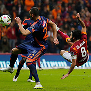Galatasaray's Selcuk Inan ( R) during their Turkish Super League soccer match Galatasaray between Istanbul Basaksehir at the AliSamiYen Spor Kompleksi TT Arena at Seyrantepe in Istanbul Turkey on Saturday, 14 March 2015. Photo by Aykut AKICI/TURKPIX