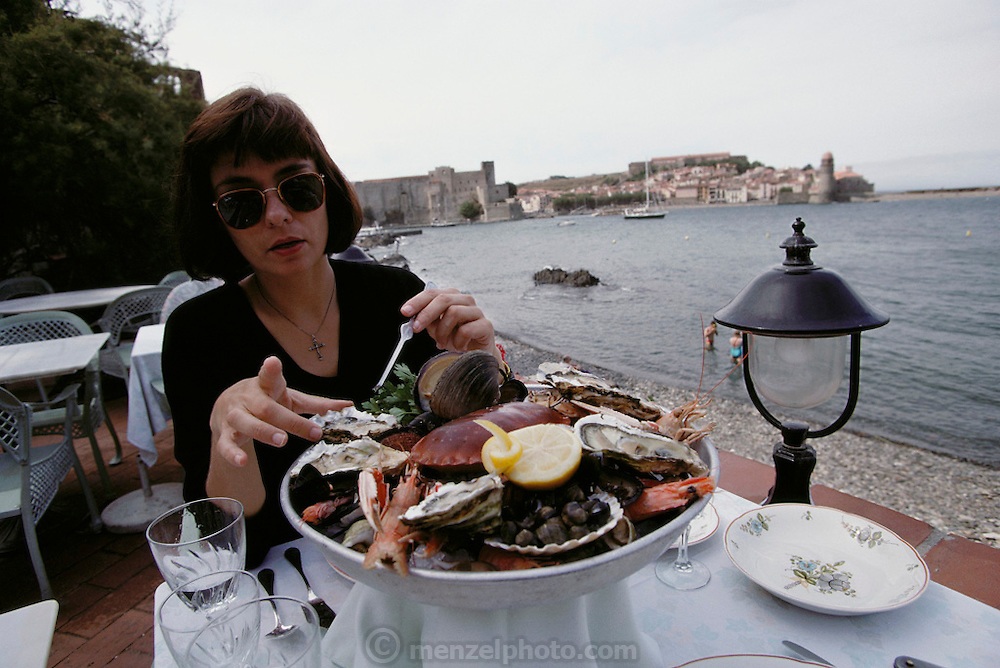 Faith D'Aluisio eats shellfish at a seaside restaurant at Collioure, France. MODEL RELEASED.