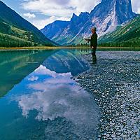 A fisherman casts into Glacier Lake, below Cirque of the Unclimbables
