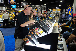 Attendees view Firearms on display at the 2017 NRA Annual Meetings and Exhibits in Atlanta