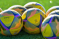 The training balls lie on the field in the sun training session for Hibernian FC at the Hibs Training Centre, Ormiston, Scotland on 26 February 2021, ahead of the SPFL Premiership match against Motherwell.