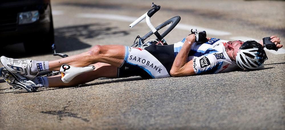 France, Col-du-petit-Saint-Bernard, 21-07-2009.<br /> Cycling, Tour de France.<br /> Jens Voigt, a german rider of the Saxo Bank cycling team, has been crashed extremely heavy in the descent of the Col-Du-Petit-Saint-Bernard.<br /> Photo: Klaas Jan van der Weij