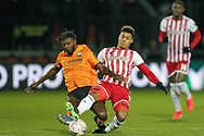 Barnet forward Medy Elito (21) tackled by Brentford forward Ollie Watkins (11) during The FA Cup fourth round match between Barnet and Brentford at The Hive Stadium, London, England on 28 January 2019.
