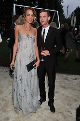 RUTA GEDMINTAS and LUKE TREADAWAY at the annual Serpentine Gallery Summer Party sponsored by Burberry held at the Serpentine Gallery, Kensington Gardens, London on 28th June 2011.