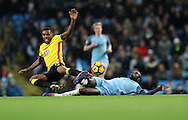 Yaya Toure of Manchester City tackles Jerome Sinclair of Watford during the English Premier League match at The Etihad Stadium, Manchester. Picture date: December 12th, 2016. Photo credit should read: Lynne Cameron/Sportimage