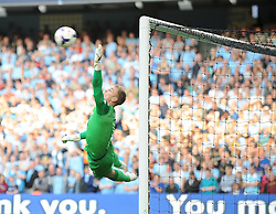 Manchester City's Joe Hart attempts to make a save - Photo mandatory by-line: Dougie Allward/JMP - Tel: Mobile: 07966 386802 22/09/2013 - SPORT - FOOTBALL - City of Manchester Stadium - Manchester - Manchester City V Manchester United - Barclays Premier League