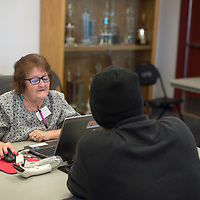 Volunteer Margaret Montoya signs in voters for the municipal election Tuesday in Gallup.
