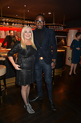 VANESSA FELTZ and BEN OFOEDU at the 2014 Costa Book of The Year Awards held at Quaglino's, Bury Street, London on 27th January 2015.  The winner of the Book of The Year was Helen Macdonald for her book H is for Hawk.