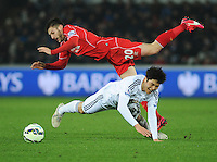 Liverpool's Adam Lallana is fouled by Swansea City's Ki Sung-Yueng<br /> <br /> Photographer Kevin Barnes/CameraSport<br /> <br /> Football - Barclays Premiership - Swansea City v Liverpool - Monday 16th March - The Liberty Stadium - Swansea<br /> <br /> © CameraSport - 43 Linden Ave. Countesthorpe. Leicester. England. LE8 5PG - Tel: +44 (0) 116 277 4147 - admin@camerasport.com - www.camerasport.com
