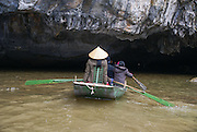 Foot rowing Tam Coc area of Ngo Dong River near Ninh Binh, Vietnam