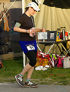 Augusta, New Jersey - A runner on the course at the 3 Days at the Fair races at Sussex County Fairgrounds on May 12, 2012. Another runner's tent and supplies are in the background.