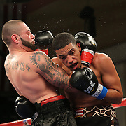 KISSIMMEE, FL - MARCH 06:  Emanuel Sanchez (L) exchanges punches with Moises Carasquillo during the Telemundo Boxeo boxing match at the Kissimmee Civic Center on March 6, 2015 in Kissimmee, Florida. Sanchez won the bout by unanimous decision. (Photo by Alex Menendez/Getty Images) *** Local Caption *** Emanuel Sanchez; Moises Carasquillo