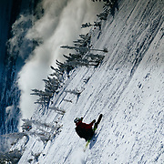 Bryce Newcomb throws a classic daffey just after sunrise at the top of Rendezvous Bowl at JHMR.