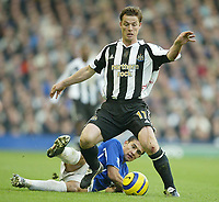 Photo: Aidan Ellis.<br /> Everton v Newcastle. The Barclays Premiership.<br /> 27/11/2005.<br /> Newcastle's Scott Parker is challenged by Everton's Tim Cahill