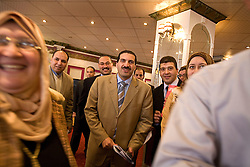 Amr Khaled, an Islamic televangelist, is seen meeting with his followers at a Life Makers gathering inside a local wedding hall, Alexandria, Egypt, Dec. 24, 2005. The former accountant with the Western-style suit and soft voice had previously been asked to leave Egypt as his revival gained strength. As a result he started preaching on several television shows, turning him into an international celebrity.