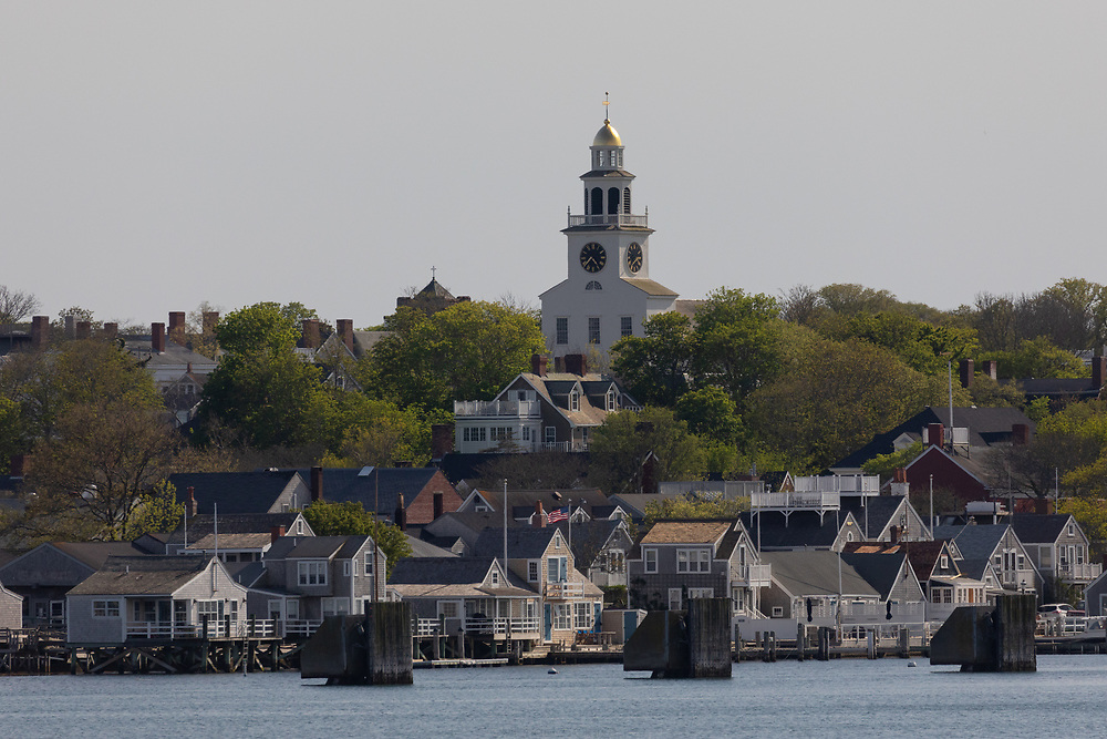 The town of Nantucket seen while approaching from the harbor on a springtime afternoon.
