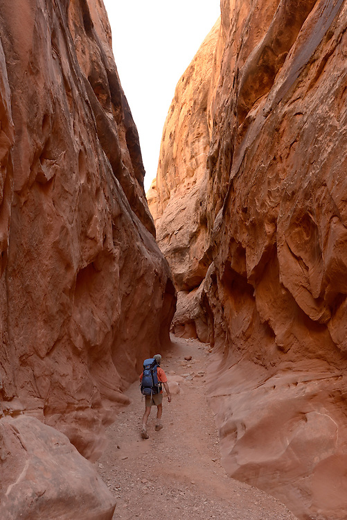 Backpacker in Little Wild Horse Canyon, San Rafael Swell, Utah.