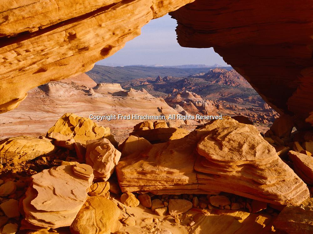 Arch in cross-bedded and wind-sculpted Navajo Sandstone, Vermilion Cliffs National Monument, Paria-Vermilion Cliffs Wilderness, Arizona.