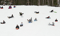 Unidentified flying objects took over Memorial Field's sledding hill during Laconia Recreation's sledding party Tuesday afternoon.  (Karen Bobotas/for the Laconia Daily Sun)
