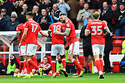 Nottingham Forest forward Daryl Murphy (9) celebrates with Nottingham Forest midfielder Mustafa Carayol (18) after scoring a goal to make it 1-1 during the EFL Sky Bet Championship match between Nottingham Forest and Wolverhampton Wanderers at the City Ground, Nottingham, England on 16 September 2017. Photo by Jon Hobley.