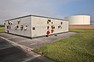 """The Holy Rosary Cemetery next to Dow Chemical (formally Union Carbide Complex) in Taft Louisiana is located across from the Mississippi River in the stretch between Baton Rouge and New Orleans, is part of a large concentration of chemical and oil companies that was formerly referred to as the """"Petrochemical Corridor,"""" but now is know as """"Cancer Alley."""" Many cases of cancer have occurred in communities on both sides of the river though the Louisiana Tumor Registry claims the numbers are not higher then the national average. Cancer Alley, Louisiana Cancer Alley"""