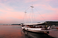 boat at sunset in the bay of beautiful portuguese colonial typical town of parati in rio de janeiro state brazil