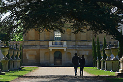 © Licensed to London News Pictures. 02/06/2013. London, UK A couple walk arm in arm against the backdrop of Chiswick House. People enjoy the sunshine in the grounds of Chiswick house, West London, today 2nd June 2013. Photo credit : Stephen Simpson/LNP